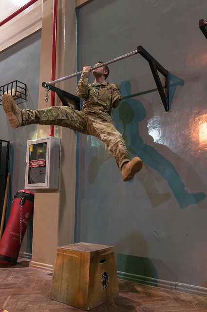 Retired U.S. Army Sgt. Noah Galloway performs a one-armed pull up on March 14, 2014 in Kabul, Afghanistan as part of Operation Proper Exit. The program is for wounded warriors. (U.S. Air Force photo/Staff Sergeant David Y. Zheng) Image from Flickr/CreativeCommons