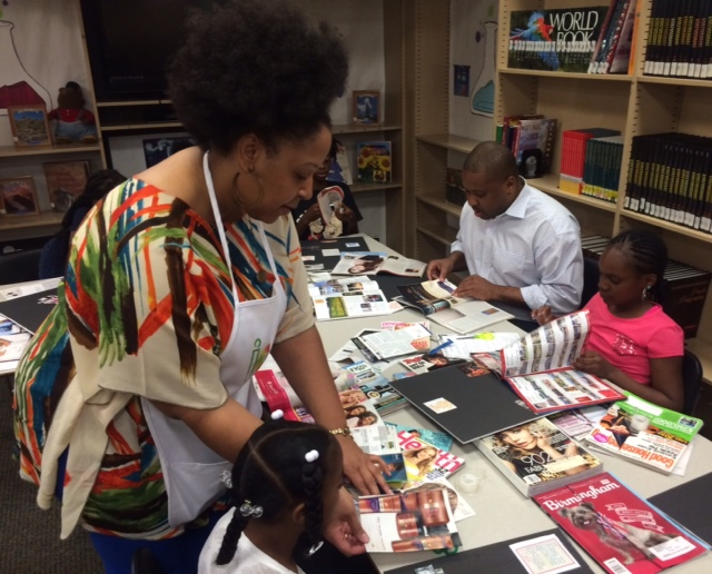 Traci Ann Moore assists children during her vision board exercise she calls Envision Me.