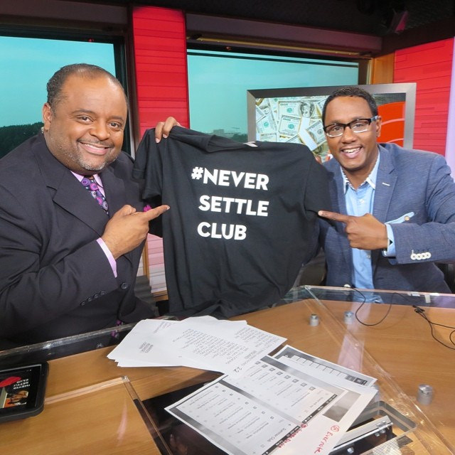 Mario Armstrong, right, appears on TV One commentator Roland S. Martin's show in July to promote the #NeverSettleClub.  Image from Roland S. Martin via Flickr/Creative Commons.