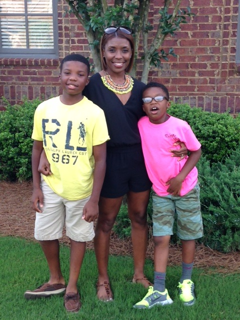 Demarish Ruffin-Scott with sons Rich, 13, left, and Reese, 9.
