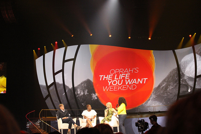"Oprah Winfrey with ""trailblazer'' presenters, from left, Rob Bell, Iyanla Vanzant and Elizabeth Gilbert on the Life You Want Tour in Atlanta. Photo by Sonya Boatwright."