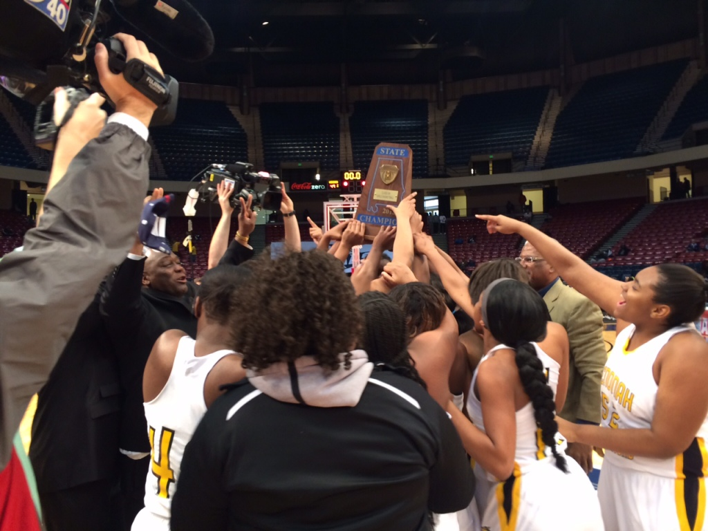 Coach Emanuel Bell, far left, celebrates with the Wenonah Lady Dragons  after winning the state 5A girls' basketball championship on Feb. 28 at the BJCC. (Photo by: Chanda Temple)