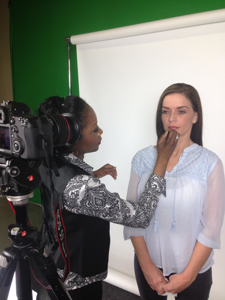 Jestina Howard preps a client for lights, camera and action. (Photo: Special)